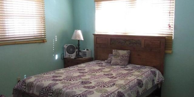Leno realty Bedroom